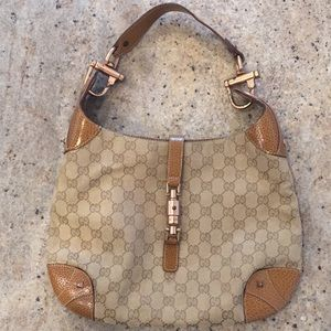 Gucci Monogrammed Canvas Hobo Bag